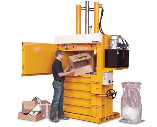 Product image of the b50 baler loaded with cardboard by the operator
